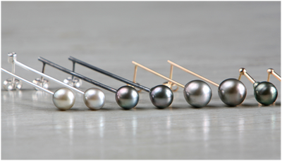 Earrings in18k gold and silver with cultured tahiti pearls and diamonds